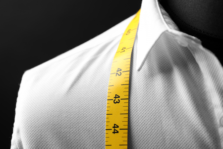 Elegant custom made shirt on mannequin against black background, closeup Reklamní fotografie