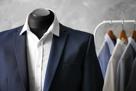Custom-made suit on mannequin in atelier, closeup Фото со стока