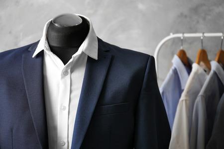 Custom-made suit on mannequin in atelier, closeup Imagens