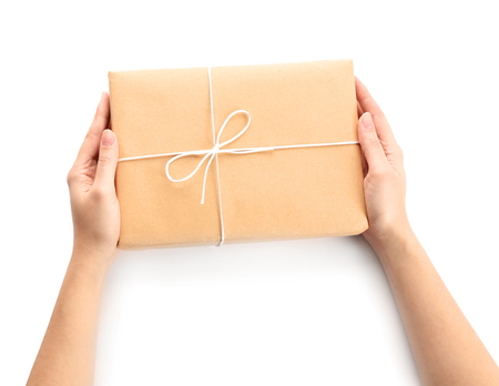 Woman with parcel gift box on white background 版權商用圖片 - 112520696