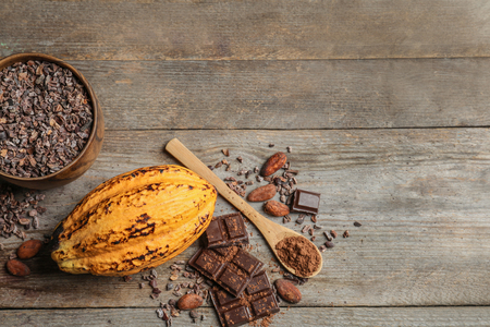 Composition with cocoa pod on wooden background