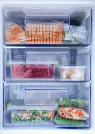 Different products in refrigerator freezer 免版税图像 - 112546397