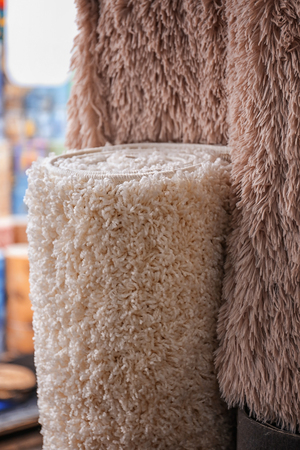 Assortment of different carpets in store