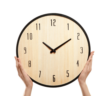 Woman with clock on white background. Time management concept Imagens