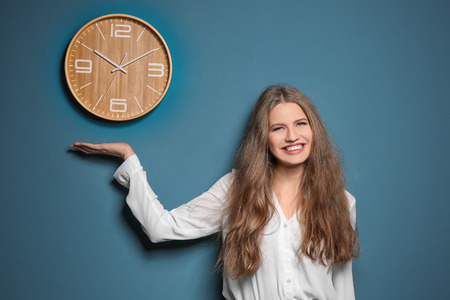 Beautiful manager near wall with clock