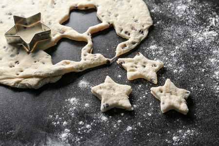 Raw dough for cookies on dark background