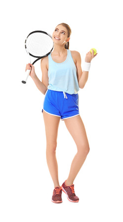 Young woman with tennis racket and ball on white background Imagens