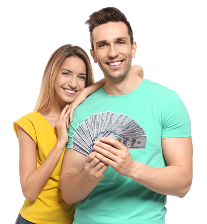 Young couple with money on white background