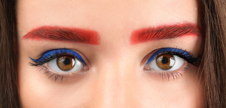 Young woman with dyed eyebrows, closeup Stock Photo