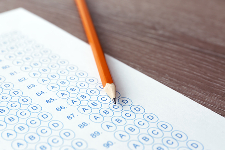 Pencil and test sheet on table, closeup. Preparation for exam Imagens