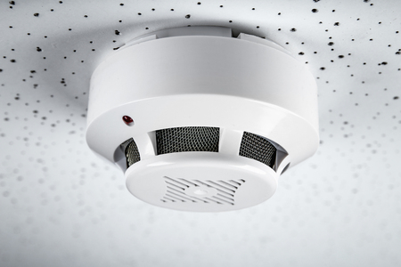 Smoke detector on light background