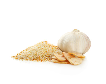 Granulated dried garlic and flakes on white background Фото со стока