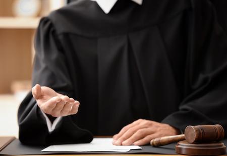 Male judge demanding bribe, closeup