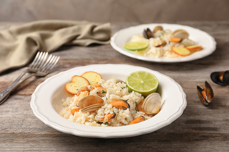 Plate with delicious seafood risotto on wooden table 版權商用圖片