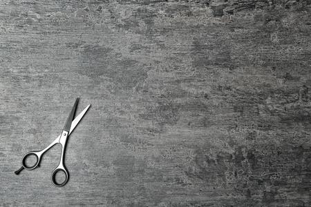 Professional hairdresser scissors on gray table Stock Photo