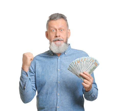 Emotional senior man with lot of dollar banknotes on white background Stockfoto