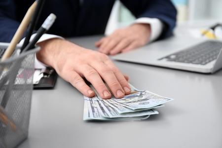 Businessman with bribe at table, closeup Stok Fotoğraf