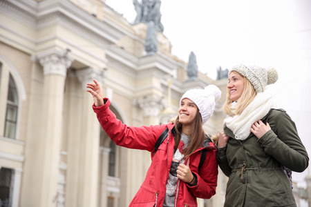 Young female tourists, outdoors Фото со стока