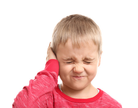 Little boy suffering from ear pain, isolated on white