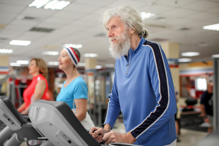 Group of elderly people training in modern gym