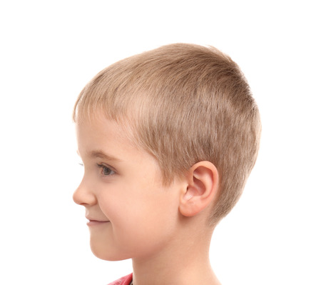 Cute little boy on white background. Hearing problem
