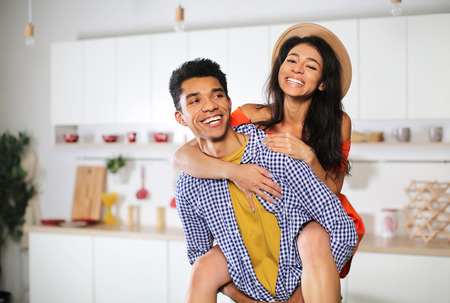 Attractive African-American couple having fun at home Stockfoto