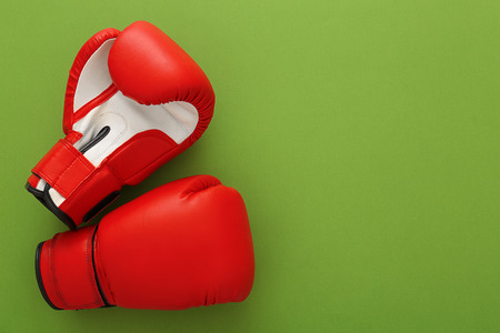 Boxing gloves with blank space for gym exercise plan on color background. Flat lay composition