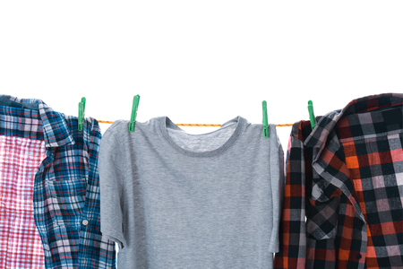 Clothes on laundry line against white background, closeup Stock Photo - 112837487