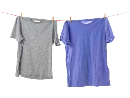 Clothes on laundry line against white background Stock Photo - 112837767