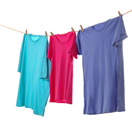 Clothes on laundry line against white background Stock Photo - 112895926