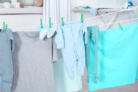 Clothes hanging on laundry line indoors