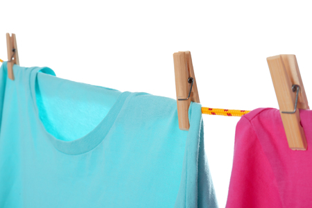 Clothes on laundry line against white background, closeup Stock Photo - 112619331