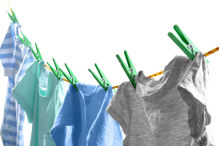 Clothes on laundry line against white background, closeup Stock Photo - 112619365