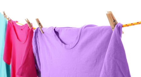 Clothes on laundry line against white background, closeup Stock Photo - 112619813