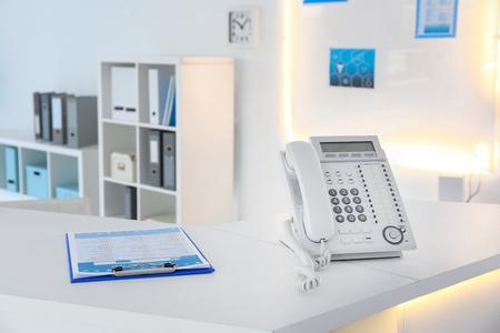 Telephone on reception desk in modern hospital Banque d'images
