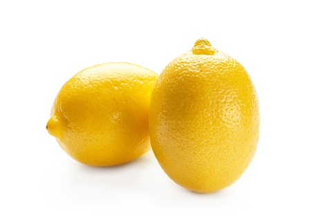 Fresh ripe lemons on white background