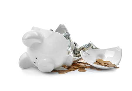 Broken piggy bank with money on white background Stock Photo