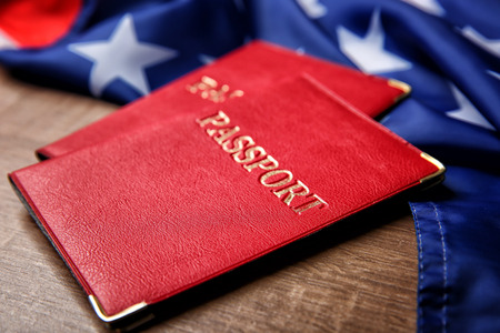 Passports and USA flag on table. American visa concept 写真素材