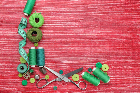 Colorful threads and sewing accessories on wooden background Stock fotó