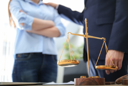 Scales of justice on table in lawyer's office Stock Photo