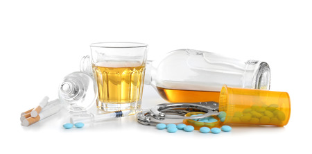 Alcohol, drugs, cigarettes and handcuffs on white background