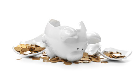 Broken piggy bank with money on white background Banco de Imagens