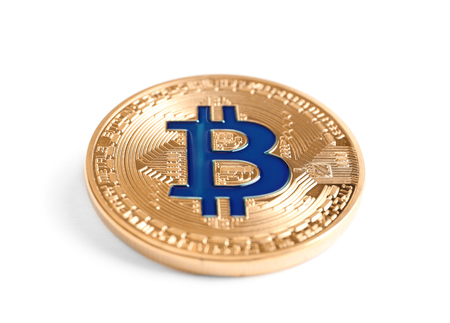 Golden bitcoin on white background Banco de Imagens