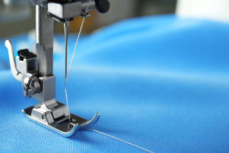 Sewing machine with fabric and thread, closeup