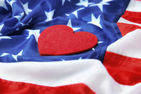 Red felt heart on American flag. USA holiday