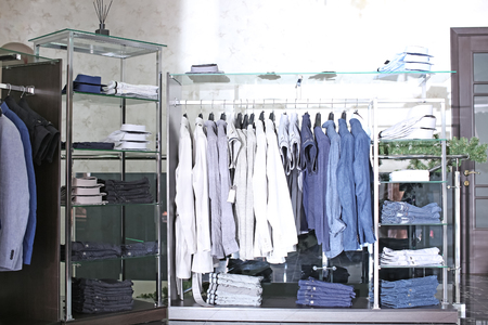 Rack with men's clothes in boutique
