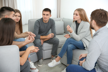 Young people during group therapy, indoors