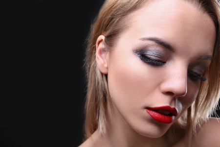 Portrait of beautiful young woman with eyelash extensions on dark background Stock fotó