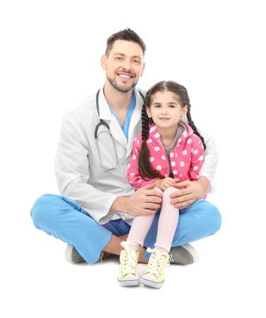 Children's doctor with little girl on white background 版權商用圖片