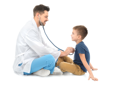 Children's doctor with little boy on white background